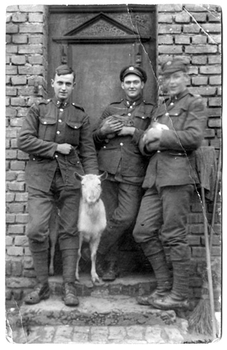 Eil, Germany, January 1919. Doc Alexander, left, with the goat. Bubby Robinson, centre. Bill Weir, right.