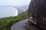 A German gun emplacement atop the west headwall with Red and White beaches in the background. Rob Alexander photo.