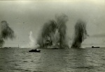 Caption written on the back of this photograph read: Actual photograph at Dieppe. One T.L.C. is in that explosion. One (TLC) to right. These things were happening all around us. Alexander family collection.