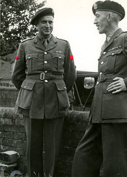 Doc Alexander, left, and John Begg. A military censor painted over Doc Alexander's regimental badges with red paint.