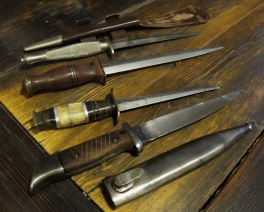 Commando daggers and a German bayonet (front).
