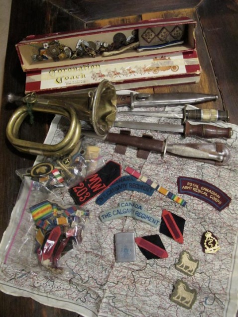 The treasure trove, including the First World War bugle and the armoured corps white ram badges.