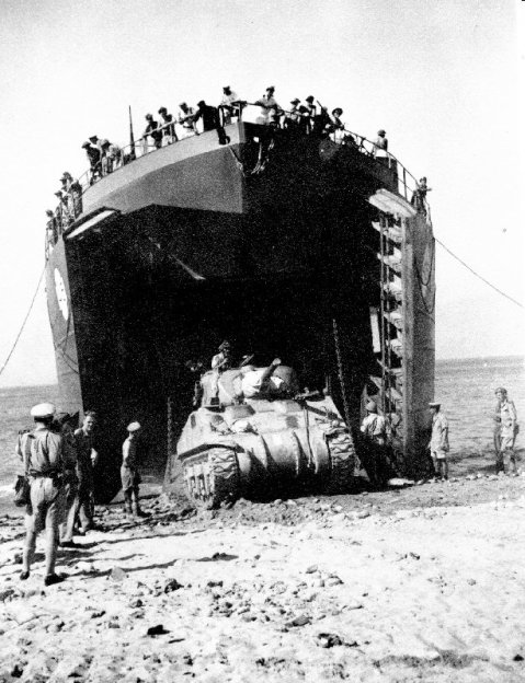 Canadian LST offloading a Sherman Tank on the beach during the Allied invasion of Sicily in 1943.