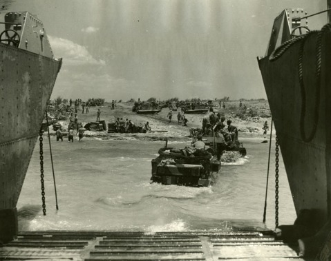 Glimpse of the invasion coast as an armoured vehicle was being towed ashore from landing craft. Alexander family collection.
