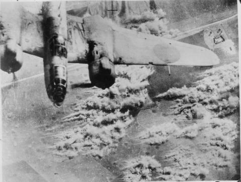 A Martin Baltimore of theTactical Bomber Force of the North West African Air Forces, flies over its target by a road in Sicily, while bombing retreating German forces heading for Messina. IWM (C3772).