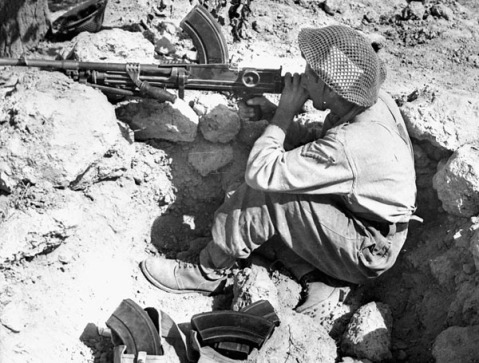 Lance-Corporal J.A. Weston, West Nova Scotia Regiment, aiming his Bren gun across the Foglia River during the advance on the Gothic Line near Montelabbate, Italy, ca. 30 August 1944. Credit: Canada. Dept. of National Defence / Library and Archives Canada / PA-184999