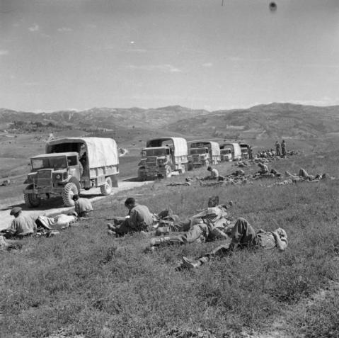 A line of supply lorries and their crews wait to move on during the breakthrough into the Gothic Line, 7 September 1944. © IWM (NA 18399)