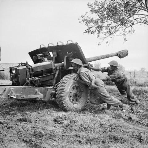 Salerno, 9 September 1943 (Operation Avalanche): During 10 - 11 September, the strength of German resistance steadily increased. A counter-attack cut the 9th Battalion, Royal Fusiliers in Battipaglia off from from the main force and required new defences to be created. A gun crew of 267 Battery, 67 Anti-Tank Regiment, Royal Artillery prepare a 17 pounder Pheasant anti-tank gun for action. © IWM (NA 6685)