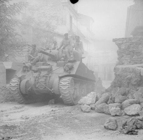A Sherman tank passes through Nicastro, 11 September 1943. © IWM (NA 6902)
