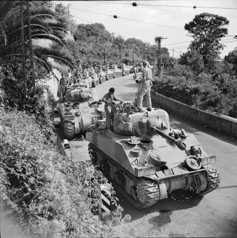 Salerno, 9 September 1943 (Operation Avalanche): By 16 September, the Allies, having rushed in reinforcements, had survived the crisis and the Germans had been ordered to withdraw to the Volturno River. The Allies were able to break out of the Salerno beachhead, link up with the Eighth Army advancing from Reggio and move towards Naples. A column of Sherman tanks waits to move forward near Cava. © IWM (NA 7158)
