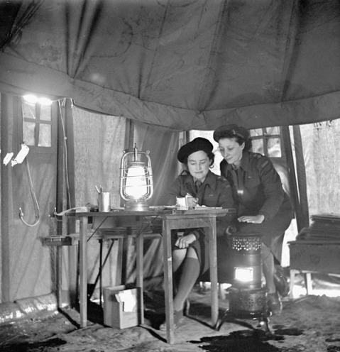 Nursing Sisters Eloise MacDiarmid and Frances Caddy on night duty, No.1 Canadian General Hospital, Royal Canadian Army Medical Corps (R.C.A.M.C.), Andria, Italy, February 1944. Credit: Lieut. Dwight E. Dolan / Canada. Dept. of National Defence / Library and Archives Canada / PA-213775