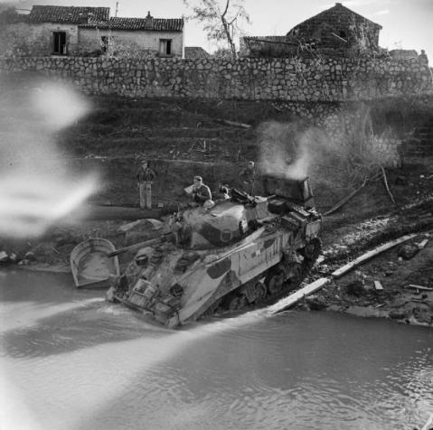 A Sherman tank of 4th County of London Yeomanry fording the Volturno river at Grazzanise, 17 October 1943. © IWM (NA 7858)