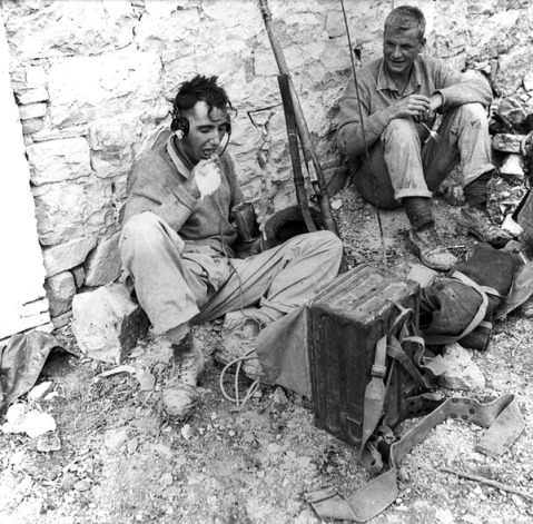 Private W.G. Turner, Royal Canadian Regiment, eating a meal during rest period, Motta, Italy, 2 October 1943.  Credit: Lieut. Jack H. Smith / Canada. Dept. of National Defence / Library and Archives Canada. PA-129778