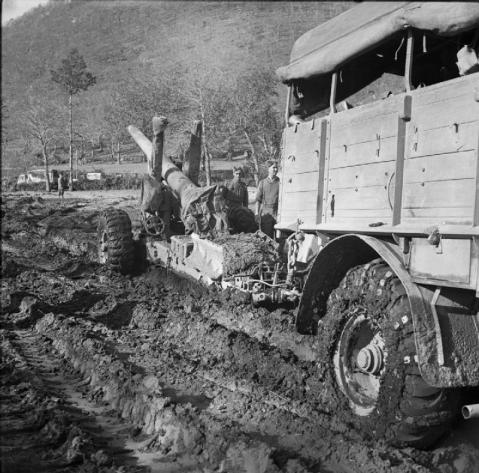 Monte Camino November - December 1943: Men of 99 Medium Battery, 74 Medium Regiment, Royal Artillery struggle to bring a 5.5 inch medium field gun into action through thick mud in the Camino area. © IWM (NA 8787)