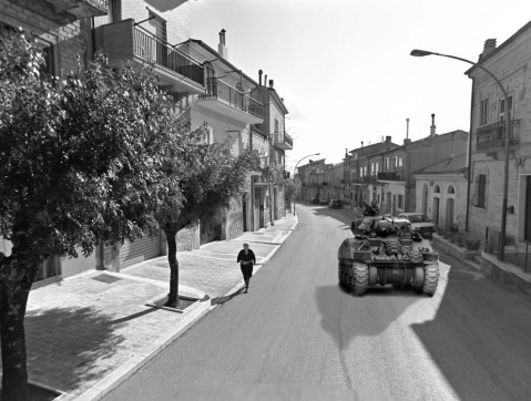 A composite photograph of a Sherman M4 tank advancing through a modern photograph taken from Google Streeview of Motta Montecorvino.