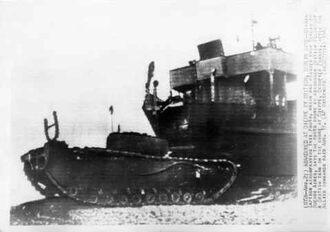 Abandoned at Dieppe by British. Berlin says: German caption accompanying this photo, which was radioed from Berlin to Buenos Aires, says the photo shows an abandoned British transport and a British tank on the shore at Dieppe, occupied France, after the Allied commando raid Aug. 19. (AP wirephoto 1942)