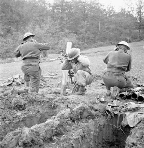 Unidentified infantrymen of the 3rd Canadian Infantry Brigade firing a mortar near the Sangro River, Italy, 1 December 1943. Credit: Lieut. Frederick G. Whitcombe / Canada. Dept. of National Defence / Library and Archives Canada / PA-153182
