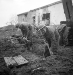 Privates J. Miller and W.H. Hall, both of The 48th Highlanders of Canada, digging a slit trench during a pause in a German counter-attack, San Leonardo di Ortona, Italy, 10 December 1943.  Credit: Lieut. Frederick G. Whitcombe / Canada. Dept. of National Defence / Library and Archives Canada / PA-167658