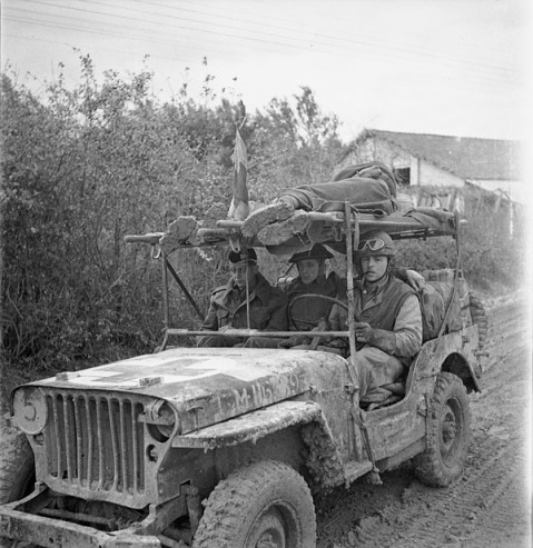 A jeep ambulance of the Royal Canadian Army Medical Corps (R.C.A.M.C.) bringing in two wounded Canadian soldiers on the Moro River front south of San Leonardo di Ortona, Italy, 10 December 1943. Credit: Lieut. Frederick G. Whitcombe / Canada. Dept. of National Defence / Library and Archives Canada / PA-180097