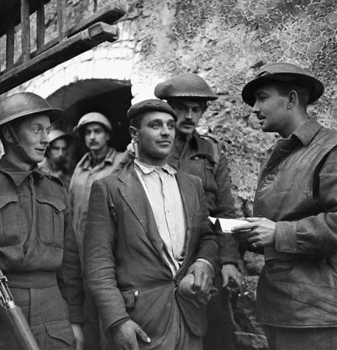 Interrogation of a German soldier who entered San Leonardo di Ortona, Italy, in civilian clothes, 13 December 1943. Credit: Lieut. Frederick G. Whitcombe / Canada. Dept. of National Defence / Library and Archives Canada / PA-180098