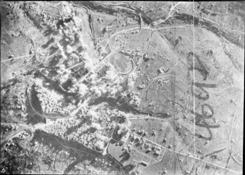 Bombs from aircraft of the Tactical Bomber Force showering roads and defended positions at Lanciano, Italy in support of the 8th Army Sangro River bridgehead.
