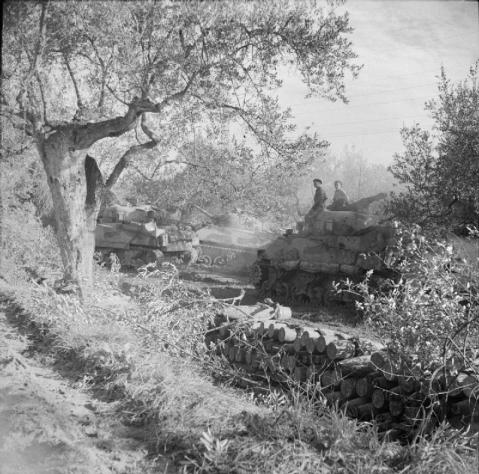 The Sangro River November 1943: Sherman tanks of the 3rd County of London Yeomanry near Torino di Sangro prepare to move up to the River Sangro. In the foreground is a pile of 4.5 inch shells waiting to be used in the artillery barrage in support of the assault. © IWM (NA 8906)