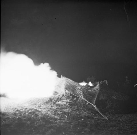 The Sangro River November 1943: A 25 pounder gun fires a round during the night barrage which enabled Allied tanks to cross the Sangro River.