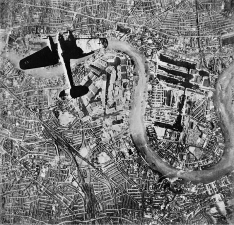 A Heinkel He 111 bomber flying over the Isle of Dogs in the East End of London, at at the start of the Luftwaffe's evening raids of 7 September 1940. © IWM (C 5422)