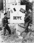 Chester McDonald and Doc Alexander pose with the entrance sign to Dieppe.