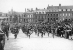 A Canadian pipe band parades through Dieppe Sept. 1, 1944, a full two years after the disastrous raid at Dieppe of Aug. 19, 1942.