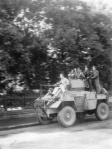 A Canadian Daimler Scout Car, carrying Canadian soldiers, zips through Dieppe, France,  Sept. 1, 1944, a full two years after the disastrous raid at Dieppe of Aug. 19, 1942.