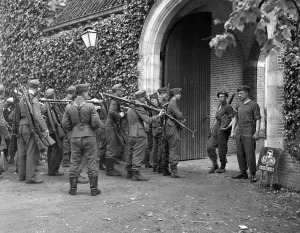 Title German soldiers entering a concentration area to be disarmed by soldiers of the 1st Canadian Corps, Amsterdam, Netherlands, 9 May 1945.  Library Archives Canada.
