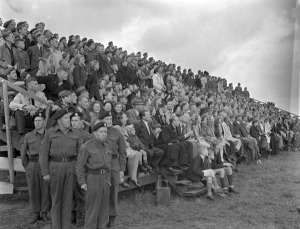 Dutch civilians watching an inspection and marchpast of the 5th Canadian Armoured Division, Eelde, Netherlands, 23 May 1945.  LAC.
