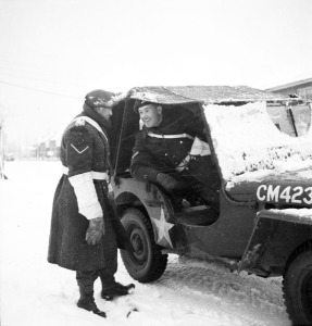 Lance-Corporal Eddie Halverson (left) talking to Lance-Corporal Phil LaRoque, Nijmegen, Netherlands, ca. 9 January 1945. LAC.