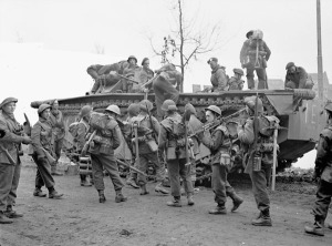 Infantrymen of the North Shore Regiment boarding an Alligator amphibious vehicle during Operation VERITABLE near Nijmegen, Netherlands, 8 February 1945. LAC.