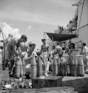 Unidentified personnel of the cruiser H.M.C.S. UGANDA setting shell fuses before the bombardment of Truk, Caroline Islands, 23 June 1945.  LAC.