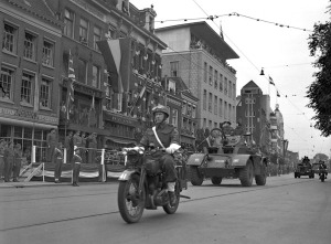 General H.D.G. Crerar taking the salute at a parade of the 3rd Canadian Infantry Division on the first anniversary of D-Day, Utrecht, Netherlands, 6 June 1945.  LAC.