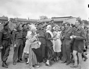 Dutch women having tea with personnel of the 3rd Canadian Infantry Division during the Division's Sports Day, Hilversum, Netherlands, 14 June 1945.  LAC.