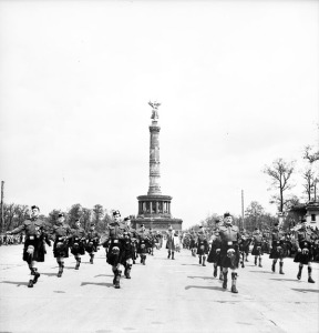 Canadian Berlin Battalion march past during a flag raising ceremony, Berlin, Germany, 20 July 1945.  LAC.