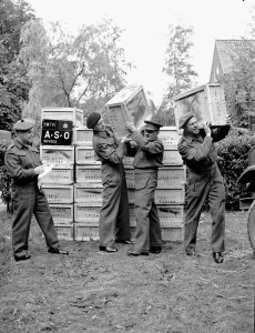 Delivery of 500,000 free cigarettes from the Overseas Tobacco League to the 5th Canadian Armoured Division, Groningen, Netherlands, 3 July 1945.  LAC.